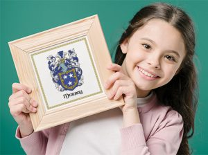 Young Girl with her family coat of arms (family Crest) Proud of her family history.