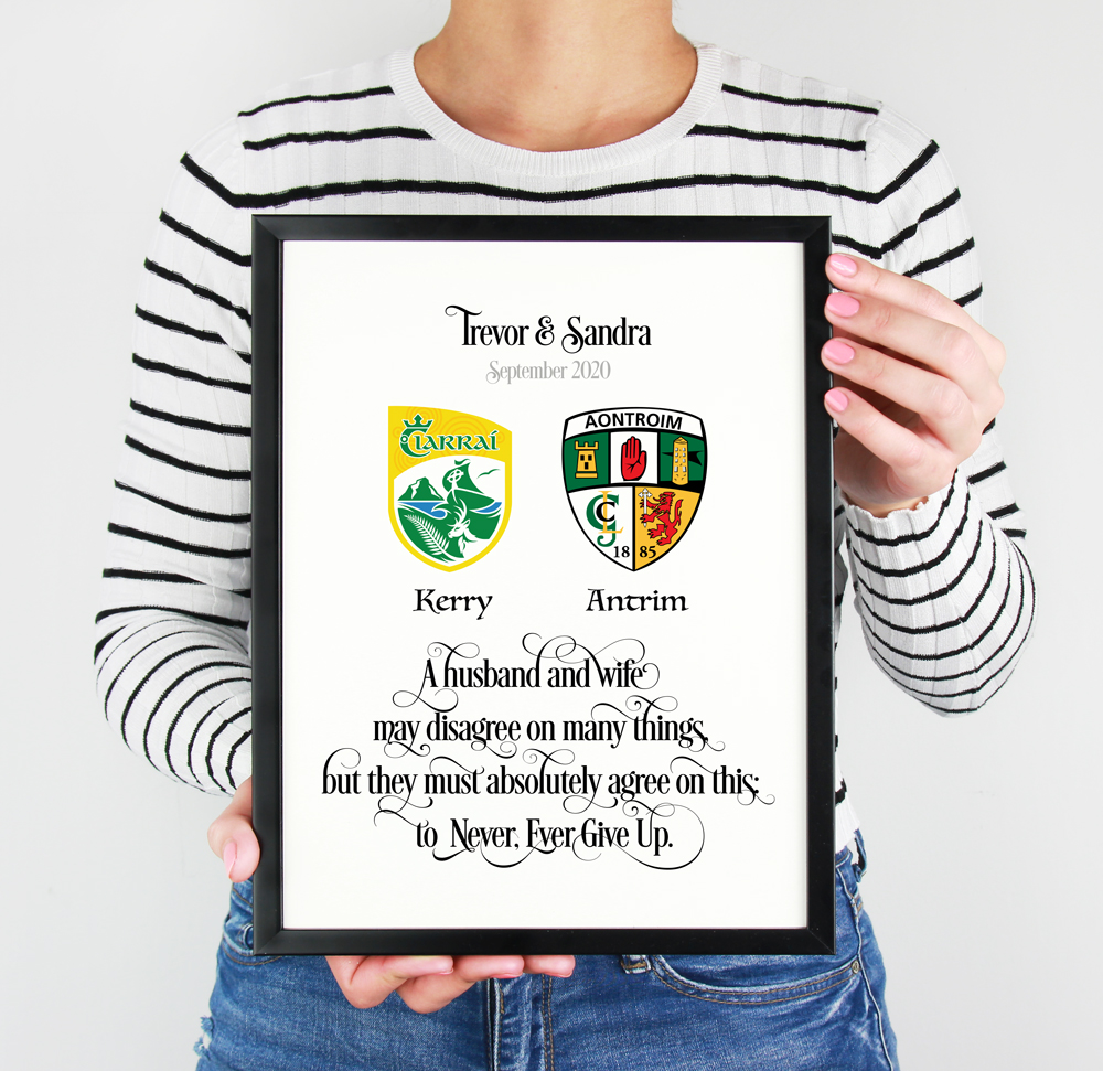 Girl Holding a beautiful personalised GAA couple print. Personalised with names and dat and a wonderful quote/verse.